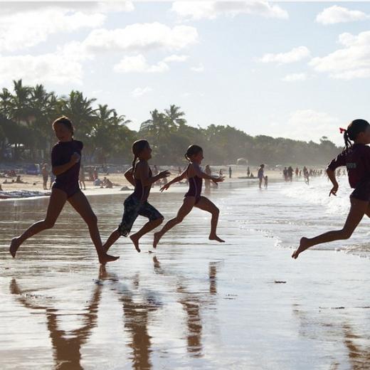 Noosa Heads, school class running on the beach