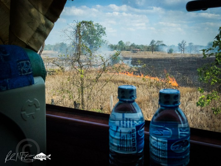 On a road trip through Laos, Reinhard Fasching photographed impressions of a bus trip through the window of the bus